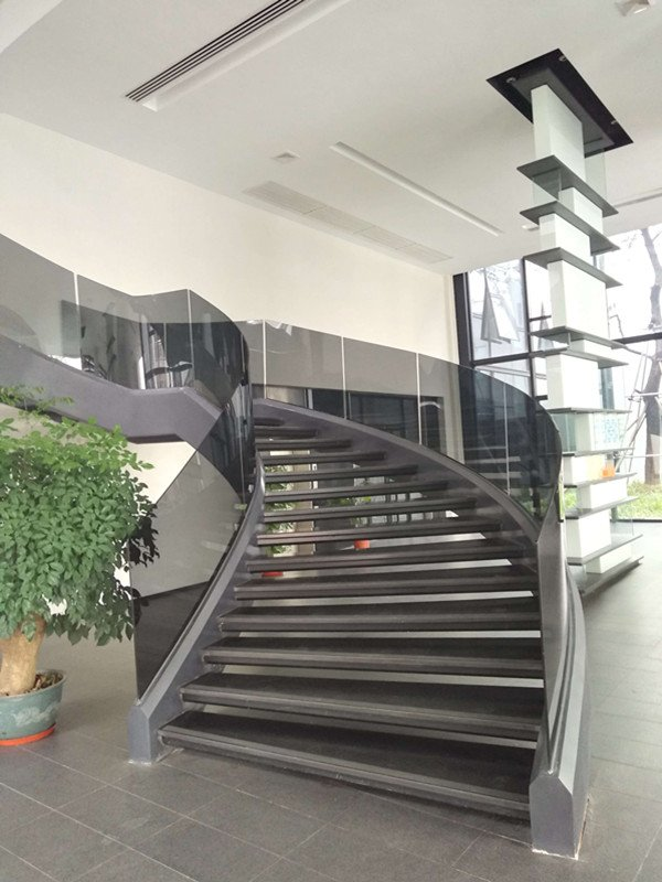 Curved Glass Balustrade Commercial Staircase | Demax Arch