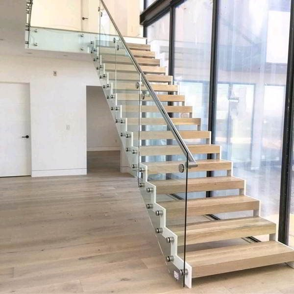 zig zag staircase with double steel stringers glass railing wood tread