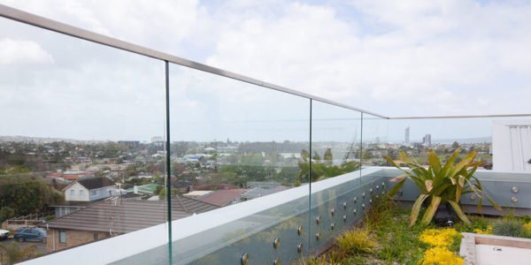 frameless glass railing with glass standoff patch fitting and glass top cap handrail