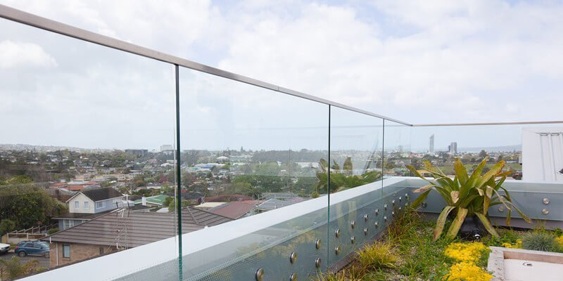 parapet frameless glass railing with glass standoff patch fitting and glass top cap handrail