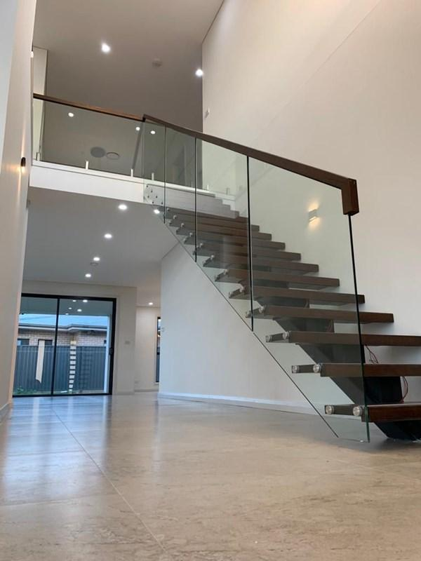 Mono Stringer Modern Staircase with Glass Railing in Sydney Australia