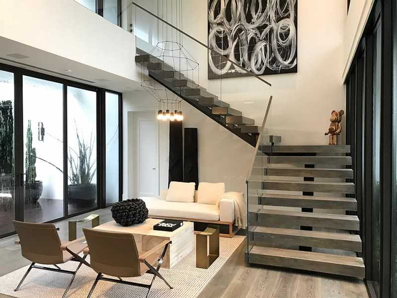 modern floating stair with glass railing and red oak tread Los Angeles